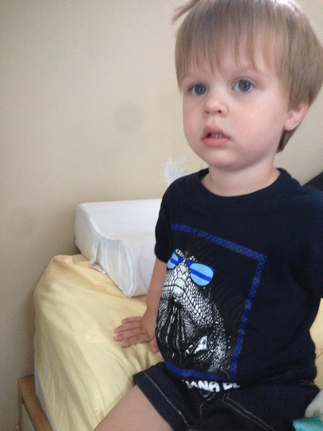 """His shirt says """"bad as iguana be"""" and he utterly loves it."""